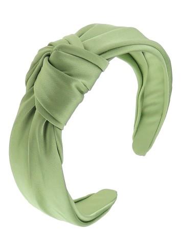 Diadema verde con nudo para invitadas a eventos.