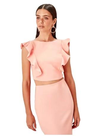 conjunto de falda y top con manga ángel en color rosa realizado en un fabuloso crepe de Lauren Lynn London