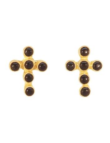 Pendientes en forma de cruz negros y dorados de Acus en INVITADISIMA.
