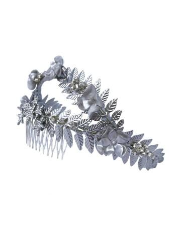 Tocado joya en plata con flores de porcelana y detalles en strass de Belen Antelo