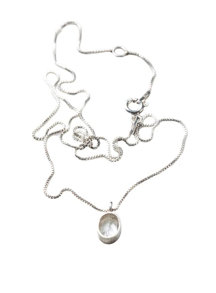 Silver necklace with white quartz by Eme Jewels at INVITADISIMA