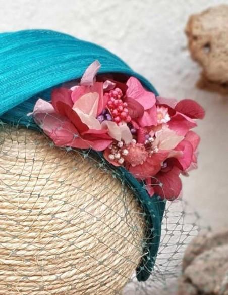 Diadema turquesa con flores preservadas para fiesta