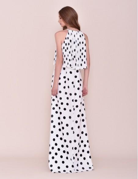 Long white dress with black moles and a halter neck at INVITADISIMA