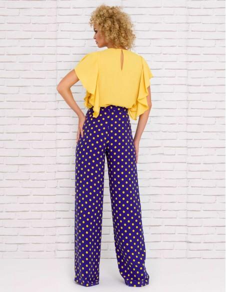 Long, high-waisted pants with polka dots