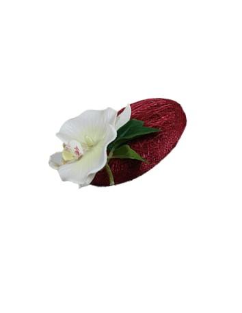 Tocado con orquidea en color burdeos de Luisa Monzón