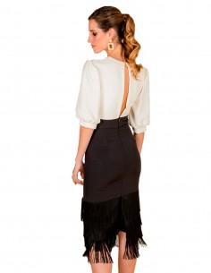 Vestido cóctel blanco y negro con falda de flecos de Cayro