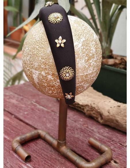 Black padded headband with golden jewels