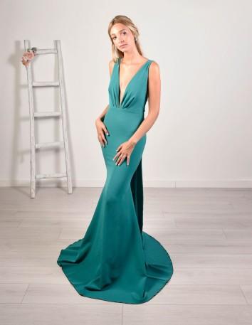 Long aquamarine dress with mermaid cut and neckline