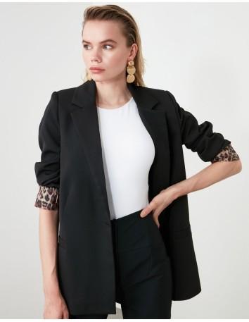 Black jacket with leopard print cuffs