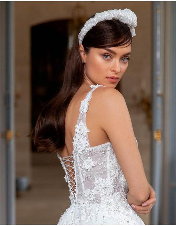 Diadema nudo de pedrería para novia