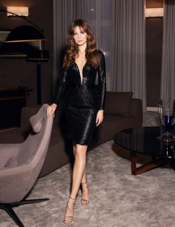 Vestido de fiesta corto de lentejuelas negras y escote sensual