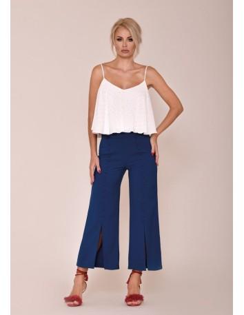 Pantalón ancho con abotonadura y abertura delantera