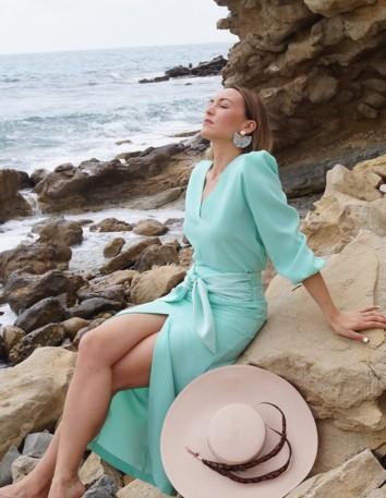 Aqua green blouse with long sleeves and a V-neckline at INVITADISIMA