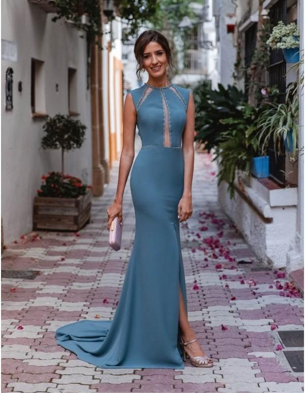 Vestido de fiesta largo con pedrería y transparencias azul